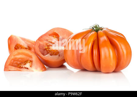 Beef tomatoes isolated on white background one whole big ripe red sliced half and two pieces flesh with seeds - Stock Photo