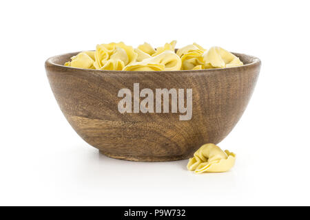 Raw Italian tortellini pasta in a wooden bowl isolated on white background traditional - Stock Photo