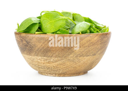 Fresh baby spinach leaves in a wooden bowl isolated on white background - Stock Photo