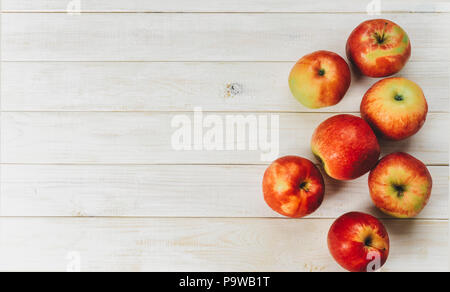 Top view of red apples on white background - Stock Photo