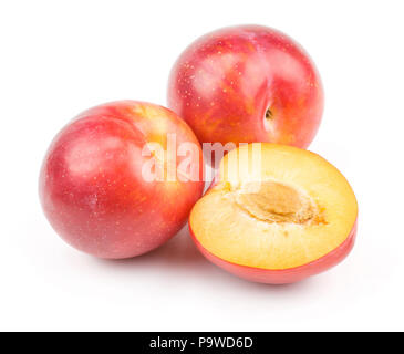 Plums red orange two whole one half isolated on white background fresh and glossy - Stock Photo