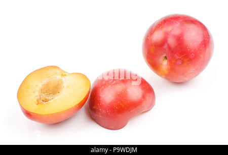 Plums red orange one whole two fleshy halves isolated on white background fresh and glossy - Stock Photo