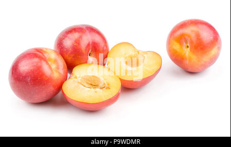 Three plums red orange and two halves isolated on white background fresh and glossy - Stock Photo