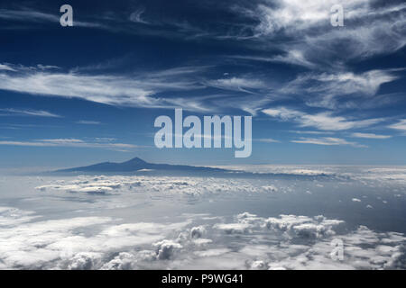 View from the airplane, Teide with cloud sky, Tenerife, Canary Islands, Spain - Stock Photo