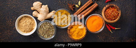 Traditional Indian spices on rusty background - Stock Photo