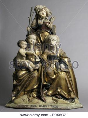The Virgin and Child, Saint Anne, and Saint Emerentia, 1515–30, Made in possibly Hildesheim, Lower Saxony, Germany, German, Limewood, paint and gilding, Overall: 33 1/4 x 22 5/8 x 11 in. (84.5 x 57.5 x 27.9 cm), Sculpture-Wood, The seated group of the Virgin Mary, the Christ Child, and Saint Anne is the core of the Holy Kinship (in German, Anna Selbdritt, referring to three generations of the Holy Family). A favored subject in Germany, the theme was made popular by the widespread devotion to Saint Anne encouraged by lay devotional groups dedicated to her at this time. - Stock Photo