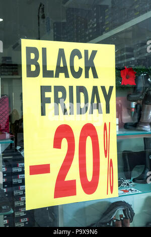 Black Friday Sale sales price reduction discount poster in a shop window, England UK - Stock Photo
