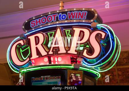 Craps machine neon sign in a Las Vegas casino, Nevada, USA - Stock Photo