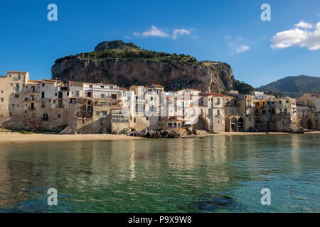 Sicily, Italy, Europe - Medieval fishermen's houses on the seafront beach in Cefalu, Sicily in summer - Stock Photo