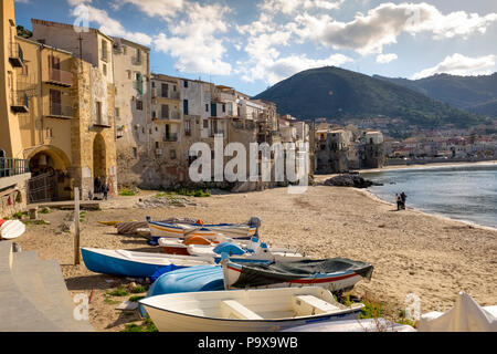 Sicily, Italy - beach with medieval fishermen's houses on the seafront in Cefalu town, Sicily - Stock Photo
