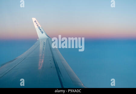 View over wing from Ryanair window seat - Stock Photo