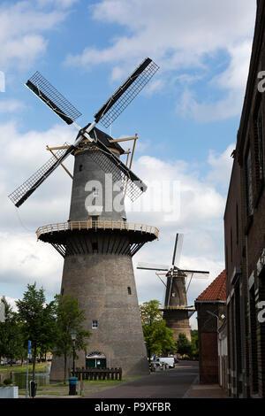 De Vrijheid, a windmill in Schiedam, the Netherlands. Schiedam has the world's tallest traditional windmills. - Stock Photo
