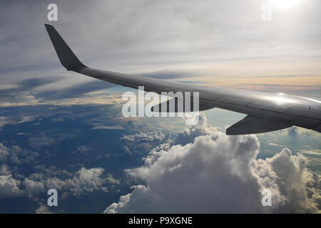 The view from a passenger jet flying high over storm clouds in the Midwestern United States. - Stock Photo