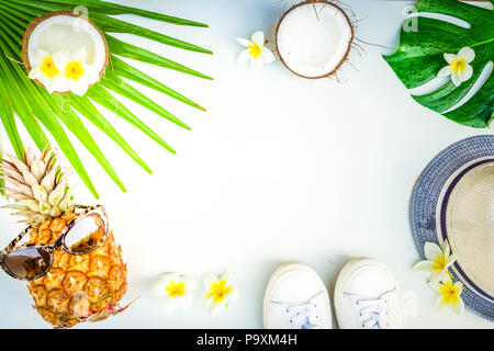 Summer flat lay frame with funny pineapple friut and tropical leaves, summer travel vacation concept, retro toned - Stock Photo