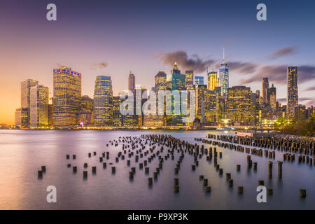 New York, New York, USA downtown skyline at dusk on the East River. - Stock Photo