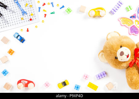 Colorful kids toys frame Teddy bear toy tools cubes blocks cars on white background - Stock Photo