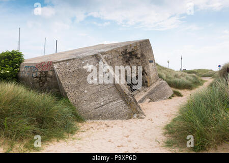 Ruined German army bunker on Juno Beach, Normandy, France - Stock Photo