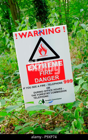 warning extreme fire danger sign in woodland, norfolk, england - Stock Photo