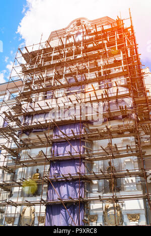 Scaffolding on the facade of beautiful building - Stock Photo