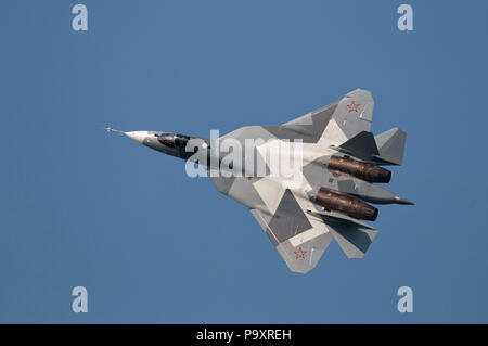 The Sukhoi T-50, a flying prototype of the stealthy, single-seat, twin-engine jet fighter of 5th generation, also designated as PAK FA, pictured durin - Stock Photo