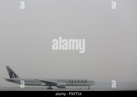 The Boeing 777-300ER widebody civil jet airplane of Qatar Airways taking off from Domodedovo Airport, Moscow Region, Russia - Stock Photo