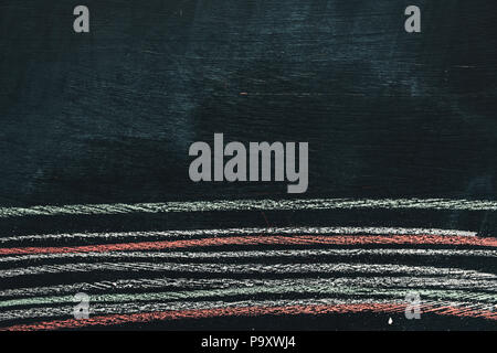 Colorful chalk striped pattern on school blackboard, close up of abstract grunge texture - Stock Photo