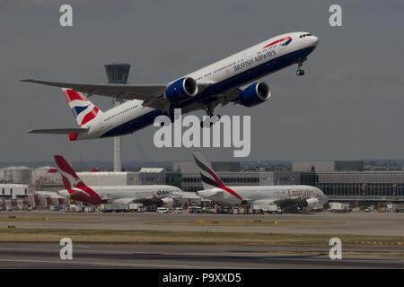 The Boeing 777-300ER civil jet airplane of British Airways pictured departing Heathrow airport, London, UK. - Stock Photo