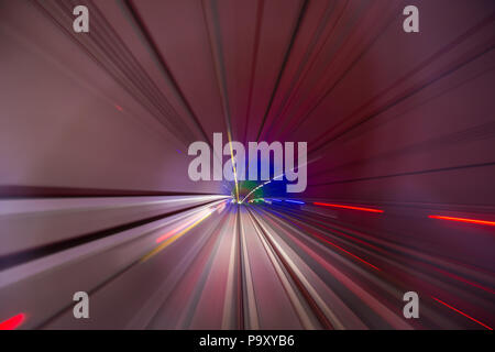 Speed blurred motion of train or subway train moving inside tunnel. - Stock Photo