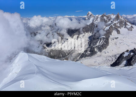 Mont Blanc mountain, view from Aiguille du Midi. France. In background Grands Jorasses mountain. - Stock Photo