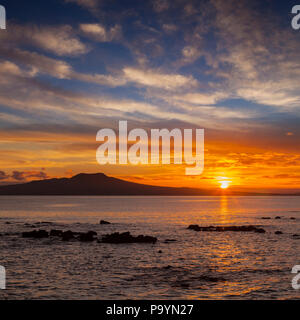 Rangitoto Island at sunrise, Auckland, New Zealand. - Stock Photo