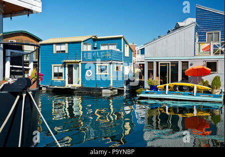 Fisherman's Wharf in Victoria, British Columbia, Canada.  Coloourful float homes on the water at Fisherman's Wharf, Victoria, BC Canada. - Stock Photo