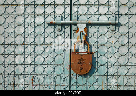 Giant lock on a door in Delhi, India - Stock Photo
