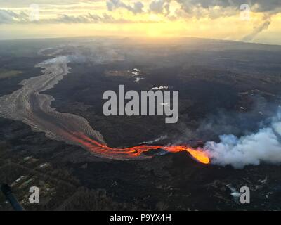 Lava and ash pour out from fissure 8 as a lava channel flows toward the ocean caused by the Kilauea volcano eruption July 17, 2018 in Hawaii. - Stock Photo