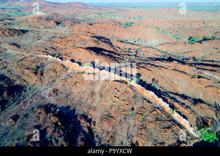 Aerial view of the China Wall, a sub vertical quartz vein protruding from the ground, Halls Creek, Kimberley,Northwest Australia - Stock Photo