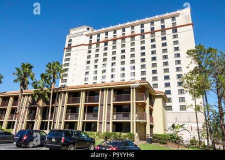 Orlando Florida Doubletree by Hilton Orlando SeaWorld hotel property grounds high rise building exterior parking lot - Stock Photo