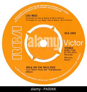 UK 45 rpm 7' single of Walk On The Wild Side by Lou Reed on the RCA label from 1972. Written by Lou Reed and produced by David Bowie and Mick Ronson. - Stock Photo