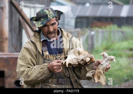 Koriak hunter with Polar Bear Skull, Kamchatka - Stock Photo