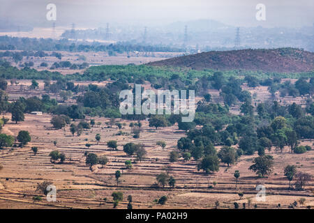 aerial photo of agro landscape of field & small forest  from a top of mountain hills  summer view of green land with fields and gardens. - Stock Photo