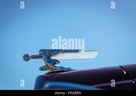 close up of chrome hood ornament on 1940 Packard super 8 - Stock Photo