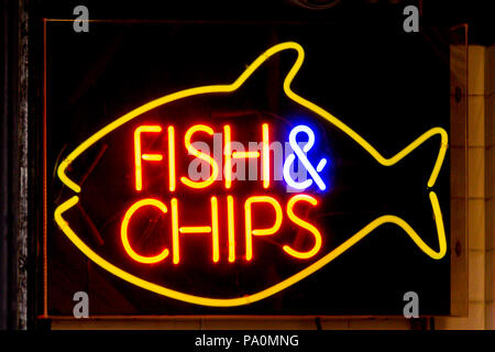 A Fish & Chips neon sign in London, England - Stock Photo