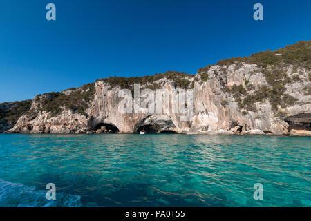 Grotta del Bue Marino on the Italian island of Sardinia from seaside - Stock Photo