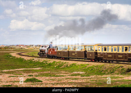 Romney, Hythe and Dymchurch Railway (RH&DR) steam train smoking engine, driver and carriages at Dungeness, Shepway district, Kent - Stock Photo
