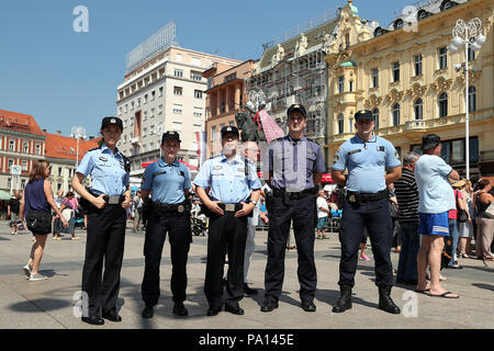 Zagreb, Croatia. 19th July, 2018. Chinese and Croatian police officers pose for photos in Zagreb, capital of Croatia, on July 19, 2018. The first joint patrol between Chinese and Croatian police during tourist season was launched on July 15. Six uniformed Chinese police officers will patrol with their Croatian counterparts in Zagreb, Dubrovnik and Plitvice Lakes National Park in Croatia until mid-August to help deal with Chinese tourists-related issues. Credit: Goran Stanzl/Xinhua/Alamy Live News - Stock Photo