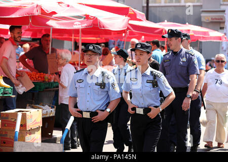 Zagreb, Croatia. 19th July, 2018. Chinese and Croatian police officers patrol together in Zagreb, capital of Croatia, on July 19, 2018. The first joint patrol between Chinese and Croatian police during tourist season was launched on July 15. Six uniformed Chinese police officers will patrol with their Croatian counterparts in Zagreb, Dubrovnik and Plitvice Lakes National Park in Croatia until mid-August to help deal with Chinese tourists-related issues. Credit: Goran Stanzl/Xinhua/Alamy Live News - Stock Photo