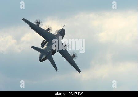 Farnborough, Hampshire, UK. 19th July, 2018. An Airbus A400-M flying during a display on day four of the Farnborough International Airshow (FIA) which is taking place in Farnborough, Hampshire, UK.  The air show, a biannual showcase for the aviation industry, is the biggest of it's kind and attracts civil and military buyers from all over the world. trade visitors are normally in excess of 100,000 people. The trade side of the show runs until July 20 and is followed by a weekend of air displays aimed at the general public.   Credit: Michael Preston/Alamy Live News - Stock Photo