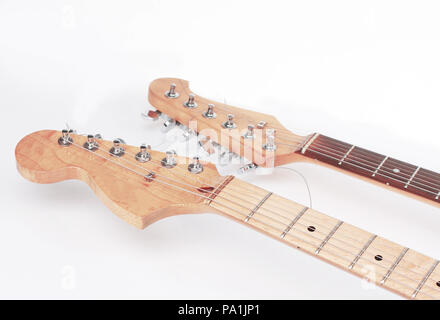 in the foreground .the fretboard of an acoustic guitar. isolate Stock Photo