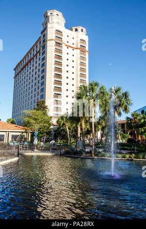 Orlando Florida Doubletree by Hilton Orlando SeaWorld hotel property grounds fountain high-rise building exterior - Stock Photo
