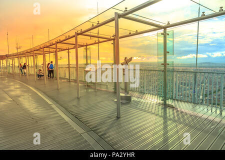 Paris, France - June 30, 2017: people at the panoramic views of Paris at sunset light at Montparnasse Observation Deck. Popular terrace on top of the highest skyscraper in Paris, capital of France. - Stock Photo