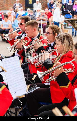 Salvation Army band performing on summer's day at the bandstand on Broadstairs seafront. View along five cornet players in red uniforms. - Stock Photo