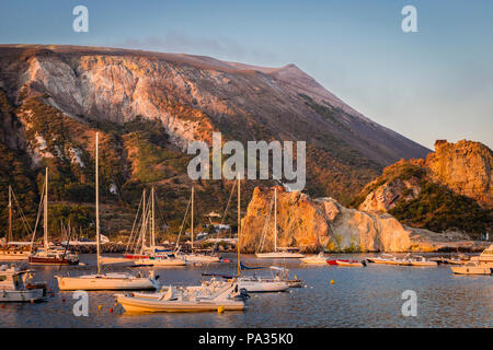 The marina of Vulcano at sunrise with the volcano slopes, Aeolian Islands, Sicily. - Stock Photo